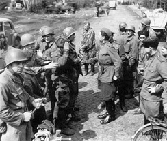 American and Soviet troops meet in April 1945, east of the Elbe River.