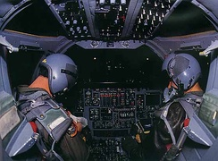 The interior of a B-1B cockpit at night