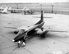 XP-87 on ramp with C-47s and B-17s in background