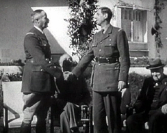 Henri Giraud and de Gaulle during the Casablanca Conference in January 1943. Churchill and Roosevelt are in the background.