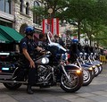 "Denver Police patrol the ""LoDo"" (Lower Downtown) district during the convention"