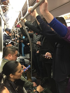 The interior of a Q train during afternoon rush hour