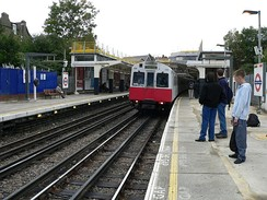 London Underground track at Ealing Common on the District line, showing the third and fourth rails beside and between the running rails