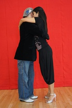 Millonguero embrace with upper body contact and lean.