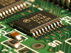 An integrated circuit (IC) on a printed circuit board. This is called a solid state circuit because all of the electrical action in the circuit occurs within solid materials.