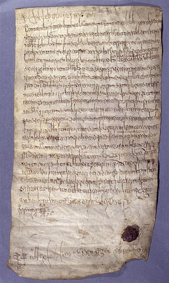 One of the oldest records in the Archives nationales : parchment dated December 23, 695. King Childebert III rules that the land of Hodenc-l'Évêque (Oise) belongs to the Basilica of St Denis.