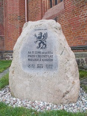 The stone near Szczecin Cathedral commemorating Kashubians with an image of the Pomeranian Griffin