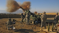 7-person gun crew firing a US M777 Light Towed Howitzer, War in Afghanistan, 2009.
