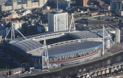 Aerial view of the four masts supporting the stadium with the roof open.