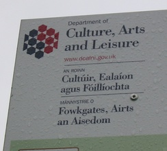 A sign for the Department of Culture, Arts and Leisure in Northern Ireland, in English, Irish and Ulster Scots.
