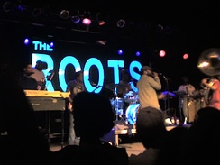 The Roots performing