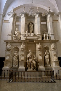 The tomb of Julius II, with Michelangelo's statues of Rachel and Leah on the left and the right of his Moses.