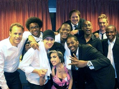 Amy Winehouse with her band backstage, 16 March 2009