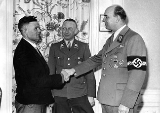 Nazi official Arthur Greiser welcoming millionth German colonist in occupied Poland - March 1944.