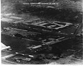 Aerial reconnaissance photos of the destroyed DAO Headquarters building with Air America Compound in the foreground
