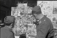 Wehrmacht troops viewing issues of Signal at a newspaper stand in Palermo, Sicily, 1943