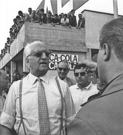 Enzo Ferrari speaks with reporters during the weekend of the 1967 Italian Grand Prix