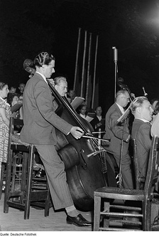 A German double bass section in 1952. The player to the left is using a German bow.
