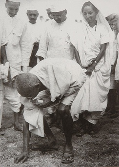 Mahatma Gandhi at Dandi 5 April 1930. Behind him is his second son Manilal Gandhi and Mithuben Petit.