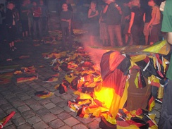 German flag being burned in a protest.