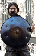Handpan player showing handpan at cathedral, Milan, Italy.jpg