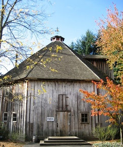 Front of an eight-sided wooden barn located on Imbrie Farm.