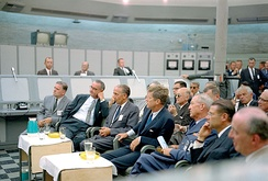 Kennedy attending a briefing at Cape Canaveral on September 11, 1962.With him in the front row are (from left) NASA administrator James Webb, Vice President Lyndon Johnson, NASA Launch Center director Kurt Debus, Lieutenant General Leighton I. Davis and Secretary of Defense Robert McNamara.