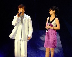 Chan and Qin Hailu singing in Shanghai, China in August 2006