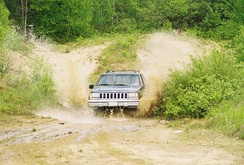One example of an off-road SUV, in this case a Jeep Grand Cherokee, in action