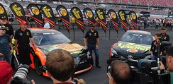 Truex standing next to his 2018 race cars