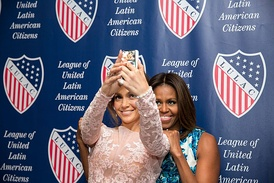 Lopez and First Lady Michelle Obama posing for a selfie at the League of United Latin American Citizens National Convention and Exposition in 2014.