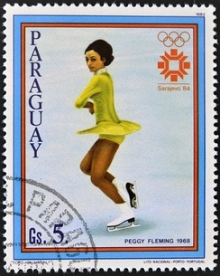 Peggy Fleming wins the only American gold medal at these Games with a chartreuse dress in reference to the Chartreuse Mountains and the French liqueur.