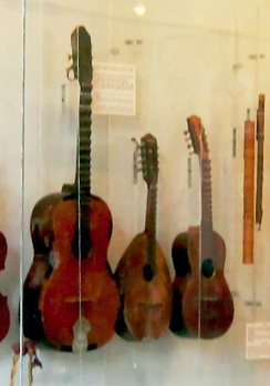 Three musical instruments with scalloped necks, guitar, mandolin, and a possible hybrid of the two.[206]