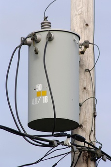 "Pole-mounted distribution transformer with center-tapped secondary winding used to provide ""split-phase"" power for residential and light commercial service, which in North America is typically rated 120/240 V.[1][2]"