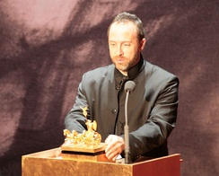 Jimmy Wales accepts the 2008 Quadriga A Mission of Enlightenment award on behalf of Wikipedia