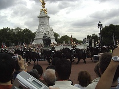 The Old Guard, formed from the Blues and Royals passing Buckingham Palace on the way back to barracks