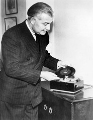 Arthur Fiedler demonstrates the new RCA Victor 45rpm player and record in February 1949.