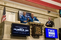 NASA astronauts Scott Altman and Mike Massimino ring the 'closing bell'.