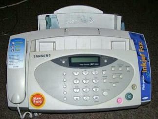 A fax machine from the late 1990s