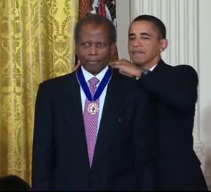 Poitier receives the Presidential Medal of Freedom from U.S. President Barack Obama in 2009.