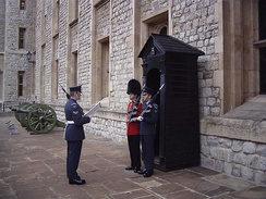 Old and new sentries (Coldstream Guards and Queen's Colour Squadron) posted at the Tower of London