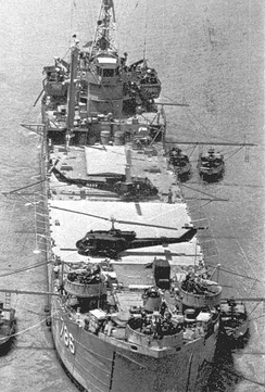 "Two UH-1B Huey gunships from HAL-3 ""Seawolf"" sit on the deck of USS Garrett County in Mekong Delta, South Vietnam."