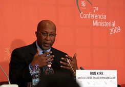 Kirk speaking at a press conference at the end of the 7th WTO Ministerial Conference