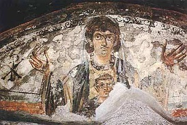 Virgin and Child. Wall painting from the early Roman catacombs, 4th century.
