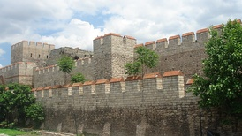 Restored section of the Theodosian Walls at the Selymbria Gate. The Outer Wall and the wall of the moat are visible, with a tower of the Inner Wall in the background.