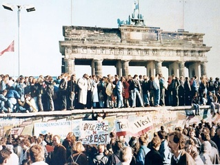 The Berlin Wall in front of the Brandenburg Gate, shortly before its fall in 1989