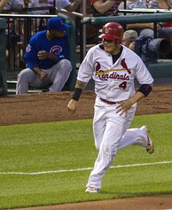 Yadier Molina tied Game 4 with an eighth-inning RBI single and later hit a walk-off sacrifice fly.