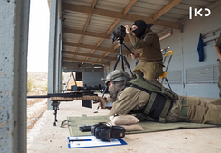 Israeli sniper and spotter team training in a sniping range.