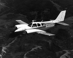 An early Baron 56TC seen in-flight.