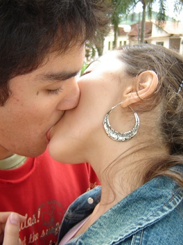 A young couple kissing